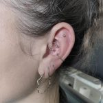 daith helix lobe piercing
